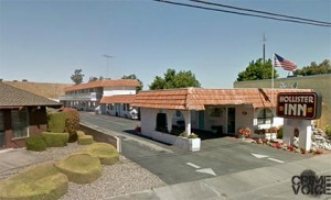 The three were found in a room at the Hollister Inn motel with drugs and a weapon.