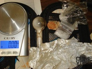 Murray's black organizer held a scale, pipe and some meth.