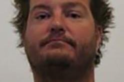 Waving Loaded Gun at Dog Earns Arrest