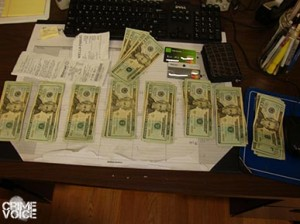 Confiscated cash, receipts, and stolen cards.