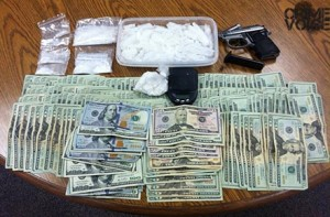Drugs, a gun, and cash were seized in the traffic stop from Schumaker's truck.