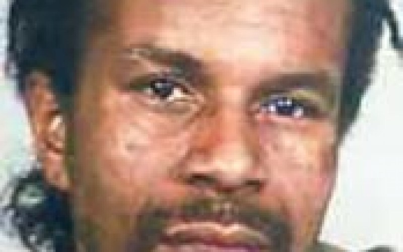 Police Search for Gang Member Suspected in Murder