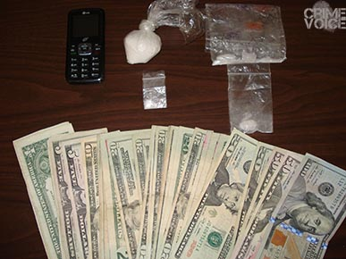 Evidence collected from Mills included Meth in plastic bags and cash.