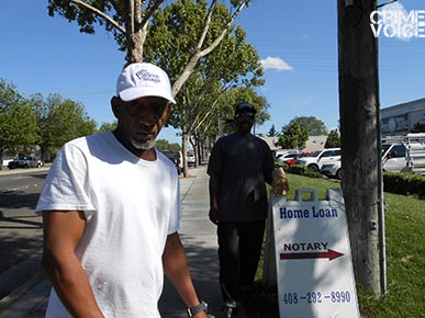 These men walking in the area were unaware of the homicide that happened the night before.