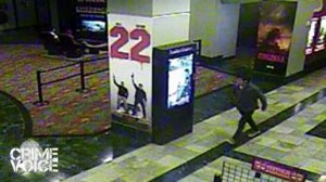 Surveillance photo shows suspect leaving the theater