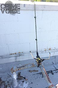 A police photographer captured this image of the hook that was thrown over the roof.