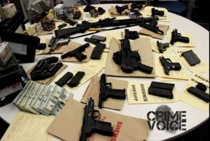 Police display the guns found at the Cuevas' home