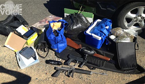 After unloading the car, officers had quite a collection of drugs and weapons on thier hands.