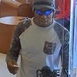 Robber leaves the bank with cash