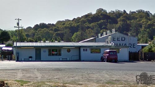 Norton was parked in front of Taylor's Tavern when see with his shotgun.