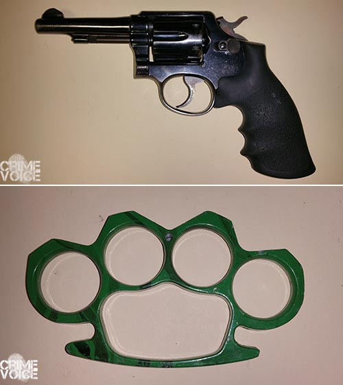 The gun and metal knuckles found in the car.