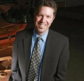 Stephen Jay Carlton in a Peninsula Symphony publicity photo.