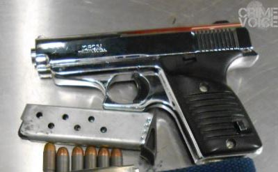 This gun was found inside the suspect car, along with a switchblade knife.