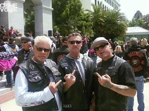 Garrett (center) posing with members of the Napa-Solano Iron Riders motorcycle club.