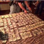 Police display approximately $8,000 apparently seized during their sting
