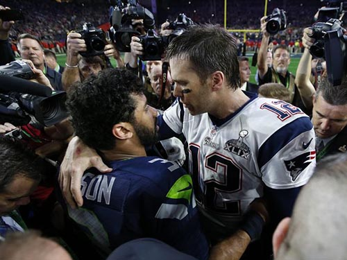 Russell Wilson and Tom Brady share a post Super Bowl hug. The violence at the game was limited to play on the field.