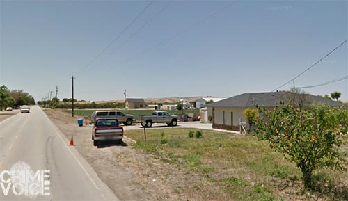 The search was at a property on Buena Vista Road near agricultural fields.