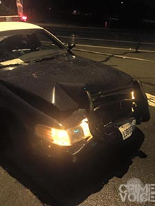 Damaged police car after the collision with Covarrubias.