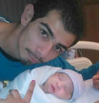 Juan Arturo Luna with his newborn baby, image from GoFundMe.com