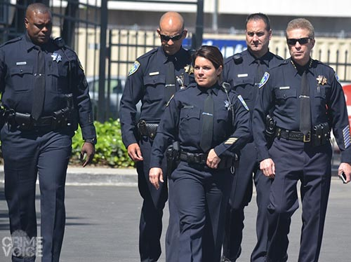 SAn Jose officers are wearing a black band around their badges in honor of their fallen comrade.
