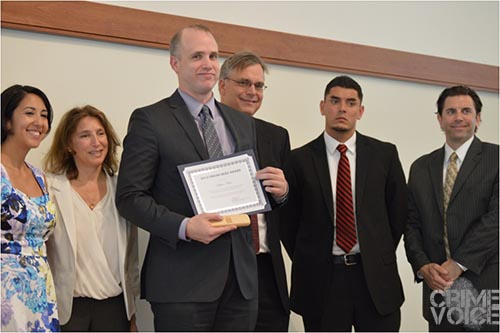 US Department of Justice Victim Witness Unit, Assistant US Attorney Stephen Meyer accepts their award.