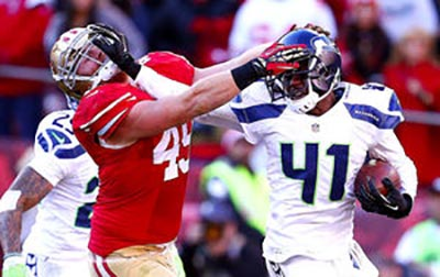 Miller - left tangles with Byron Maxwell in a game against the Seattle Seahawks (Seattle Times)