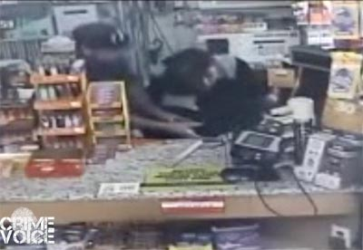 Surveillance video shows the two suspects assaulting the woman behind the counter.