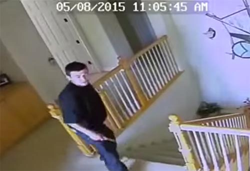 Herrera caught in the video upstairs holding a knife.