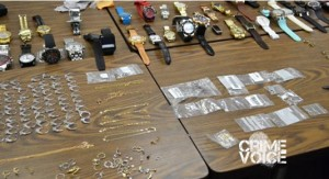 Police display some of the stolen items found in Verdin's house