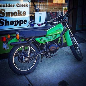 Cabibi once worked at the Smoke Shoppe - that appears to be her motorcyle in front. (Facebook)