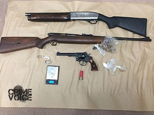 Police display weapons they confiscated