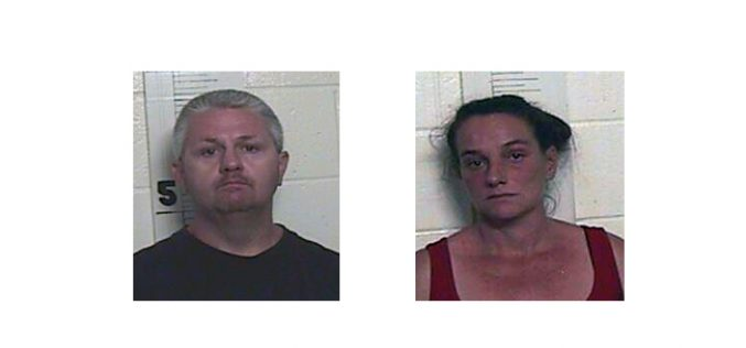 Two arrested following burglary investigation, execution of search warrant