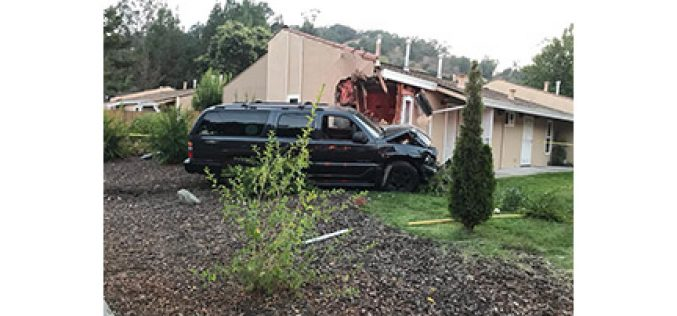 Man Drives SUV into Corner of House, Causing Big Damage