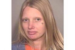 Female Arrested for Baseball Bat Attack