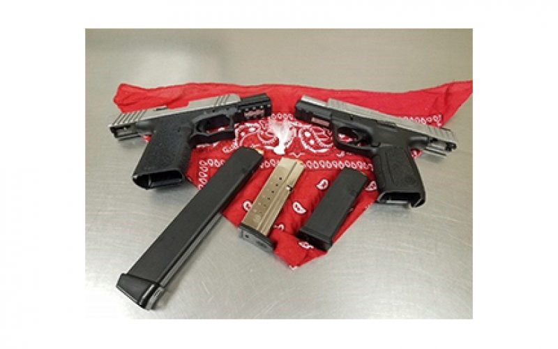 Three probationers arrested with two guns