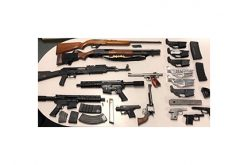 Weapons Seized during SWAT Team Raid near Police Station