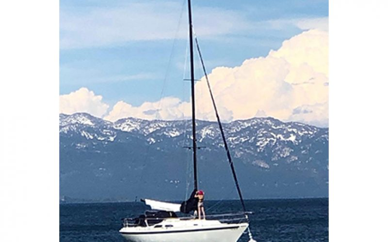 Two Girls take a dinghy for joyride on Lake Tahoe