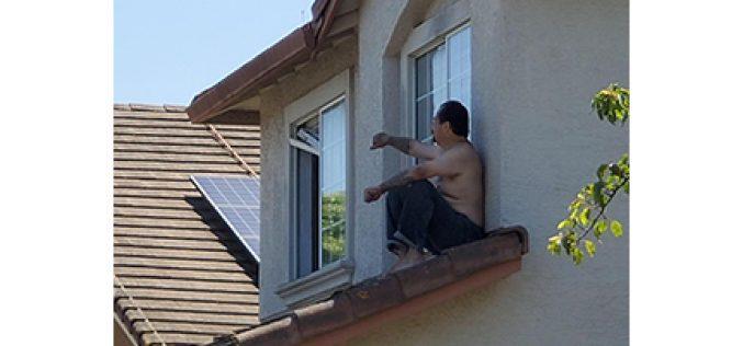 Erratic man gets on roof, rolls off into custody