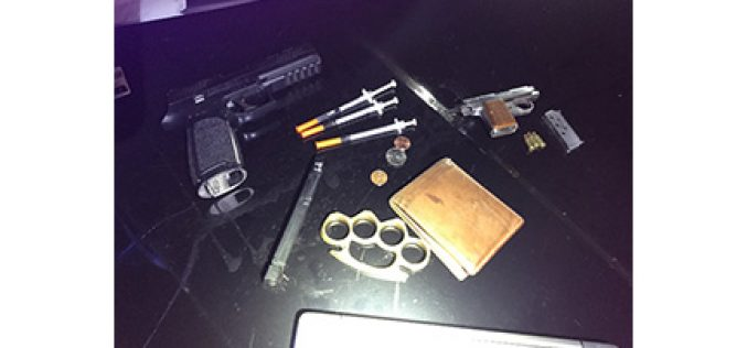 Man drives with drugs, gun, metal knuckles