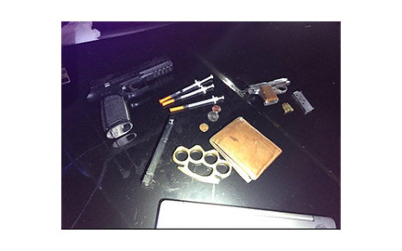 Man drives with drugs, gun, metal knuckles