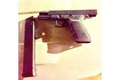 Police officers arrest gang members in possession of firearm and drugs