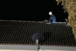 Man arrested after New Year's Day rooftop standoff
