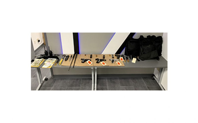 Police Track Down Armor-Clad Robbers on a Path Littered with Guns and Evidence