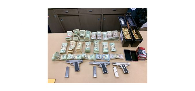 Three guns, drugs and cash seized in search warrant service