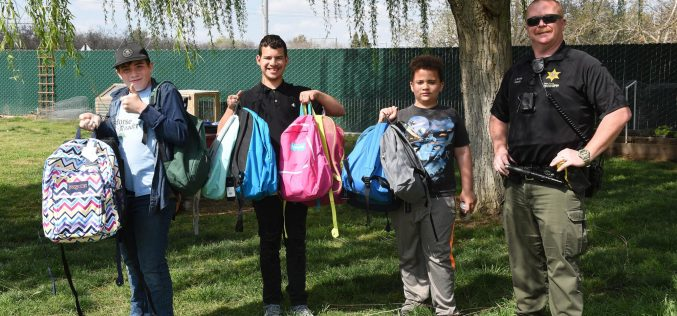 TCSO Deputy accepts backpacks for foster kids in transition