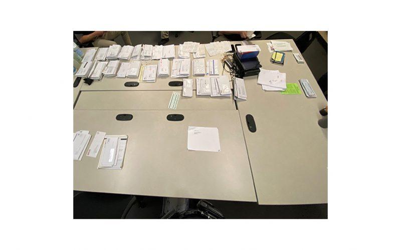 Couple with stolen car, stolen mail, fraudulent documents