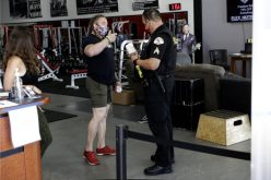 Owner reopens gym, charged with misdemeanor
