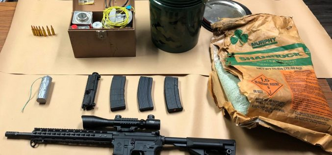 Man with active warrants arrested, gun and explosive materials seized