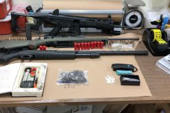 Man with felony warrant reportedly caught with weapons, drugs in car