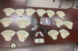 Suspicious vehicle alert leads to discovery of heroin, meth, guns